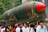 Visitors walk past China's second nuclear missile on display as they visit the Military Museum in Beijing 23 July 2007 The US military 22 July said...