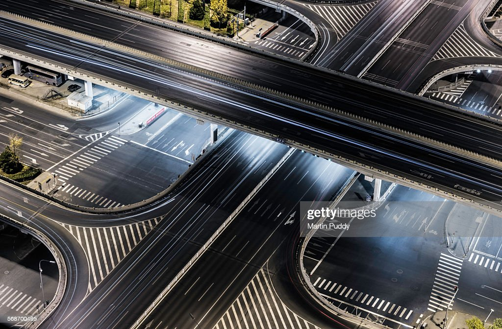 China, Beijing, close up of road intersection at night, with no traffic.