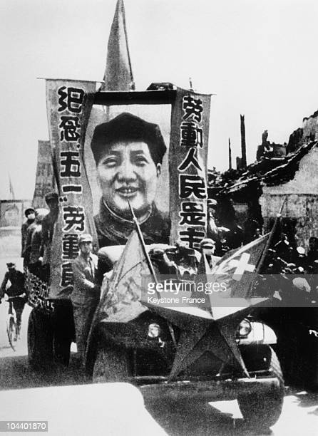 Beijing Communists commemorating the taking of Beijing in front of MAO TSE TUNG's photograph