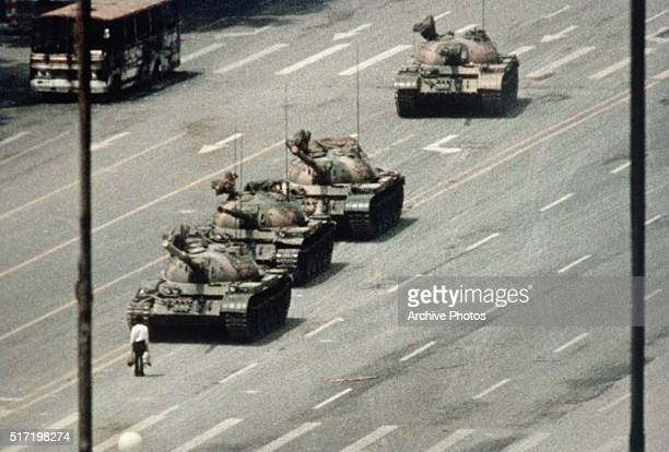 A Beijing demonstrator blocks the path of a tank convoy along the Avenue of Eternal Peace near Tiananmen Square For weeks people have been protesting...
