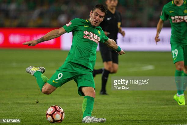 Beijing Guoan forward Jonathan Soriano takes a shot during the China Super League match between Beijing Guoan and Jiangsu FC at Beijing Workers...