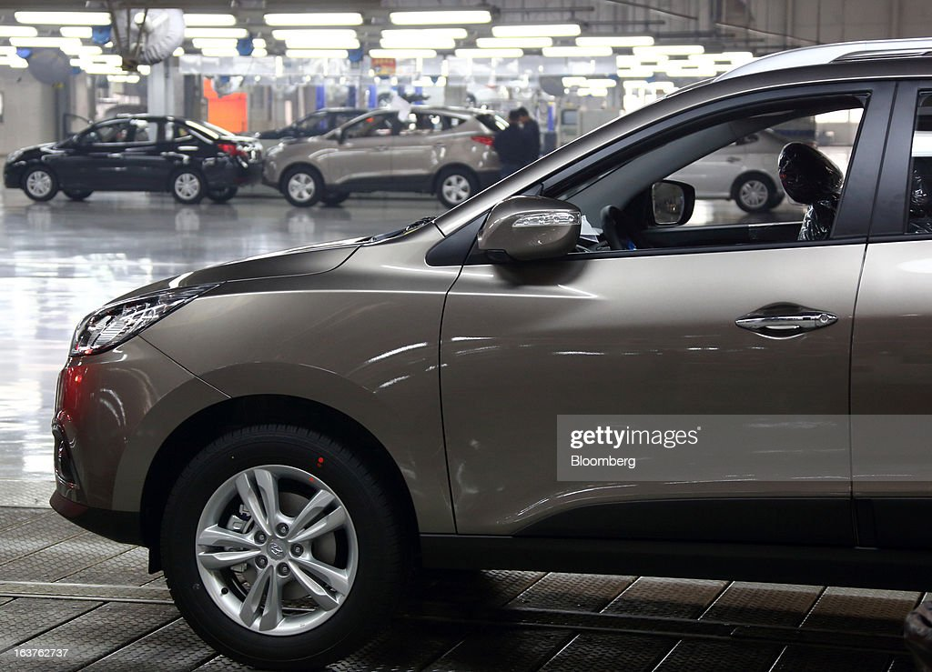 Beijing Hyundai Motor Co. cars pass through the final inspection area of the production line at the company's plant in Beijing, China, on Friday, March 15, 2013. The joint venture between Beijing Automotive Industry Holding Co. and Hyundai Motor Co., has three plants in the city, manufacturing 11 kind of models. Photographer: Tomohiro Ohsumi/Bloomberg via Getty Images