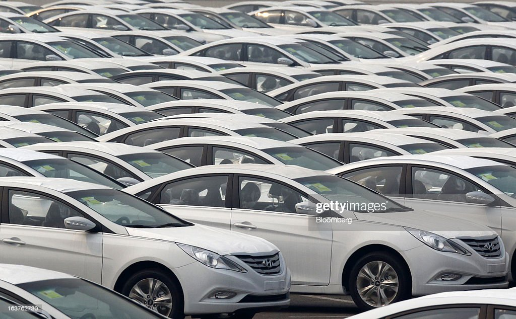 Beijing Hyundai Motor Co. Sonata sedans bound for shipment sit outside the company's plant in Beijing, China, on Friday, March 15, 2013. The joint venture between Beijing Automotive Industry Holding Co. and Hyundai Motor Co., has three plants in the city, manufacturing 11 kind of models. Photographer: Tomohiro Ohsumi/Bloomberg via Getty Images