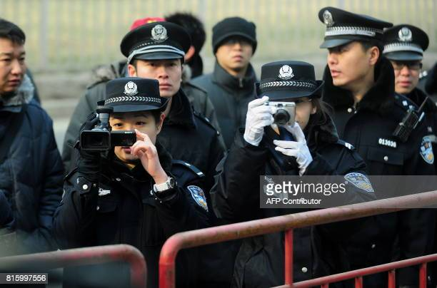 Beijing police video and photograph journalists during the trial of leading Chinese dissident Liu Xiaobo on subversion charges on December 23 2009 in...