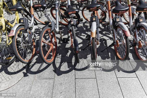 BeijingMobikeTechnology Co bicycles sit parked on a sidewalk outside a subway station in Shanghai China on Thursday Sept 12 2017 Across Chinese...