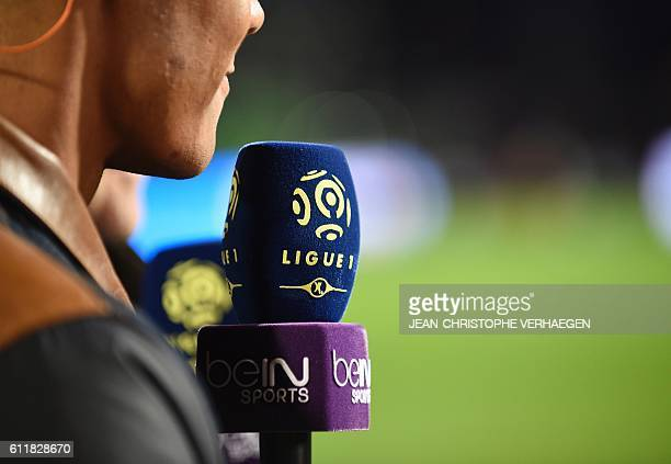 A beIN reporter covers the French L1 football match between Metz and Monaco at the Saint Symphorien Stadium in LongevilleLesMetz eastern France on...