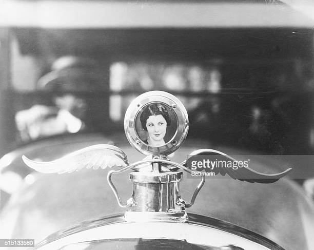 Being devoted to his famous employer Leatrice Joy's chauffeur begged for her picture with which to add the attractiveness of the limousine in which...