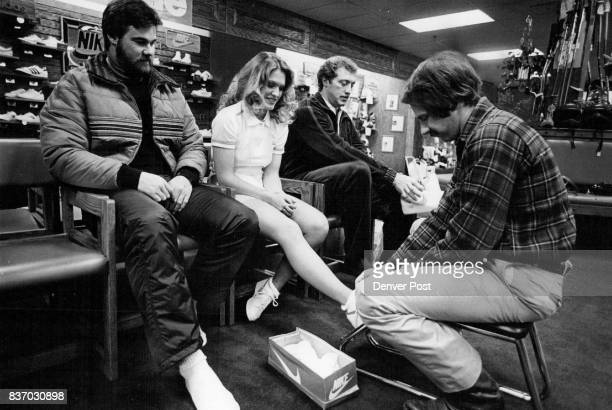 Being Fitted For Ski Boots And Tennis Shoes From left Joe Rizzo Cecilia Studdard and Dave Studdard Credit Denver Post