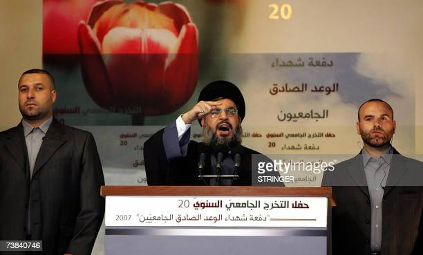 Hezbollah leader Hassan Nasrallah flanked by two bodyguards gestures during his speech during a ceremony to celebrate the graduation of some 1700...