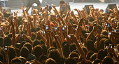 Lebanese fans use their mobile phones to take pictures of US rapper 50 Cent during his concert at Biel hall in downtown Beirut late 10 June 2006 AFP...