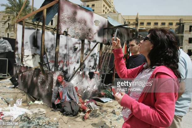Lebanese people look 13 April 2006 at a model constructed by Hezbollah in downtown Bierut in remembrance of the bombing of the Fijian UNIFIL...
