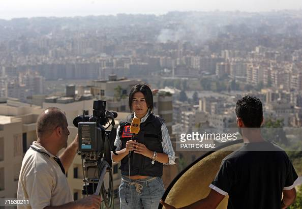 TO GO WITH AFP STORY ' MideastconflictLebanonwomenmedia' Journalist from LBCI television Mona Saliba reports in front of the camera in Beirut 24 July...