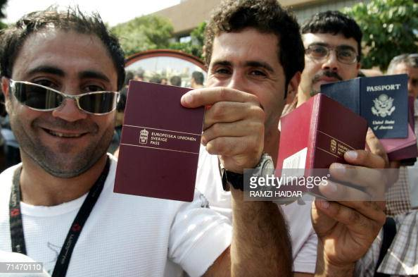Two Swedish and one American nationals display their passports as foreign nationals gather in Beirut waiting to head to the Beirut port and be...