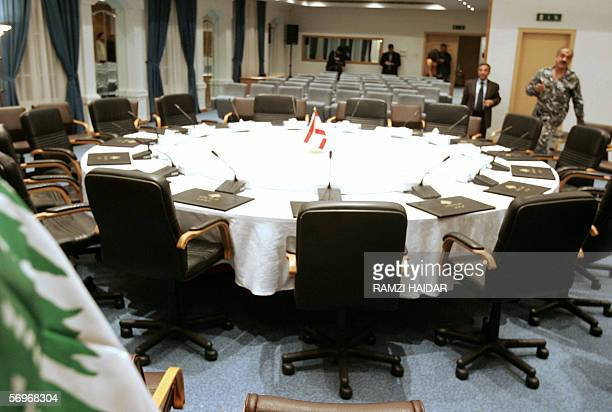 Workers prepare 01 March 2006 the roundtable conference room at the parliament building in Nejmeh Square in downtown Beirut where Lebanon's political...