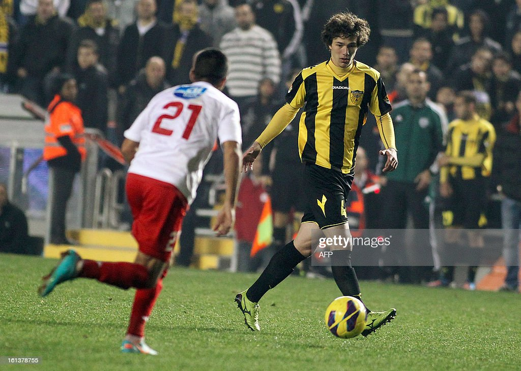 Beitar Jerusalem's Dzhabrail Kadiyev (R) vies with Bnei Sakhnin's Ahmed Kasoum (L) during an Israeli championship footbqll match at the Teddy Kollek Stadium in Jerusalem on February 10, 2013. The Beitar Jerusalem soccer club hosted the Israeli Arab team Bnei Sakhnin in a highly charged atmosphere, only three days after indictments were filed against four Beitar fans over charges relating to racism.