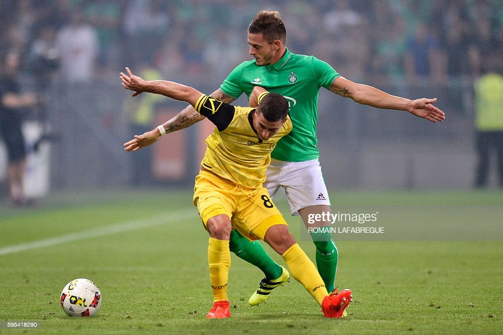 Beitar Jerusalem's Israeli forward Idan Vered vies for the ball with SaintEtienne's French forward Nolan Roux during the UEFA Europa League playoff...