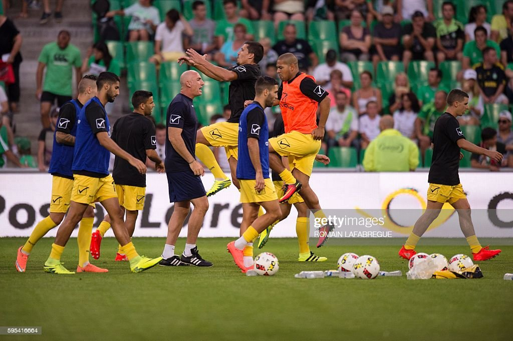 Beitar Jerusalem's players warm up before the UEFA Europa League playoff football match between AS SaintEtienne and Beitar Jerusalem at the...