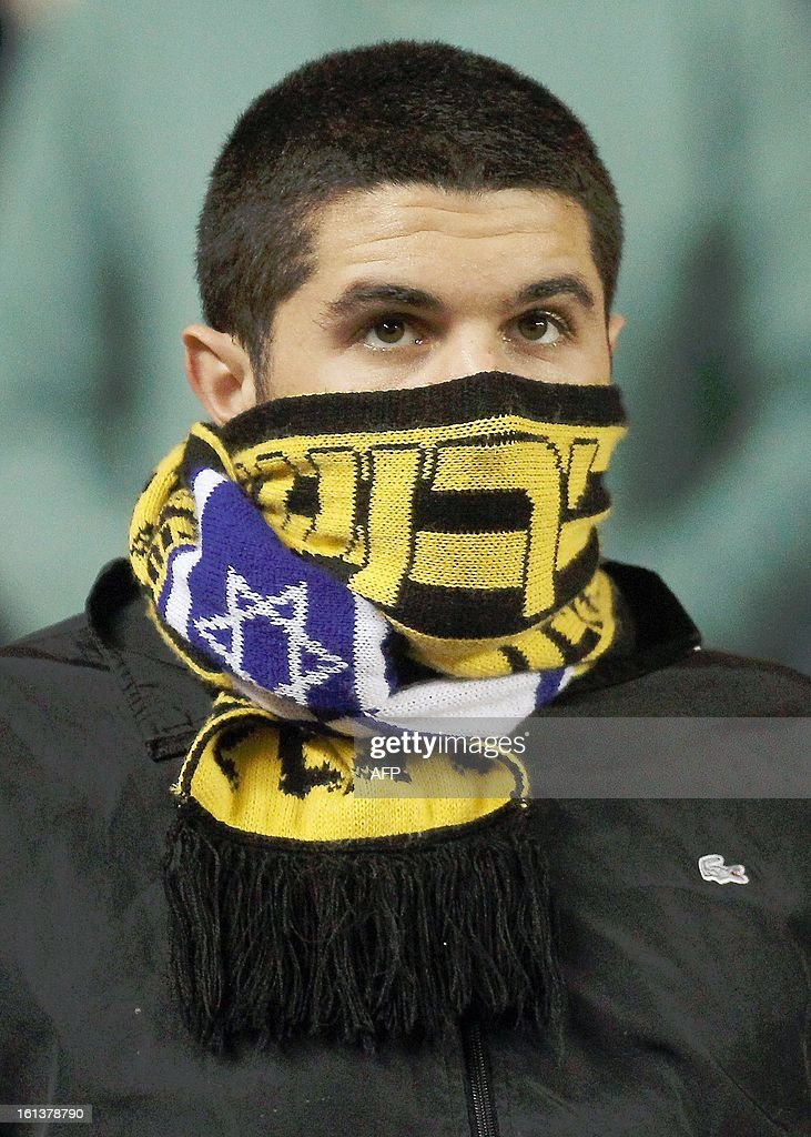A Beitar Jerusalem's supporter is attends an Israeli championship football match at the Teddy Kollek Stadium in Jerusalem on February 10, 2013. The Beitar Jerusalem soccer club hosted the Israeli Arab team Bnei Sakhnin in a highly charged atmosphere, only three days after indictments were filed against four Beitar fans over charges relating to racism. AFP PHOTO
