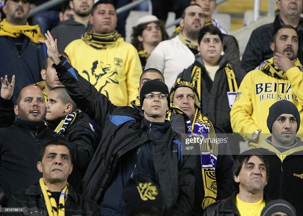 Beitar Jerusalem's supporters attend an Israeli championship football match between Beitar Jerusalem and Bnei Sakhnin at the Teddy Kollek Stadium in Jerusalem on February 10, 2013. The Beitar Jerusalem soccer club hosted the Israeli Arab team Bnei Sakhnin in a highly charged atmosphere, only three days after indictments were filed against four Beitar fans over charges relating to racism.