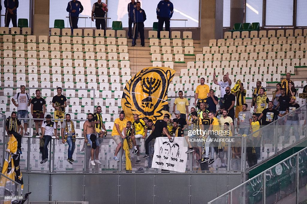 Beitar Jerusalem's supporters cheer before the UEFA Europa League playoff football match between AS SaintEtienne and Beitar Jerusalem at the...