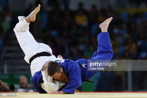Beka Gviniashvili of Georgia competes against Benjamin Fletcher of Great Britain during the men's 100kg elimination round judo contest on Day 6 of...