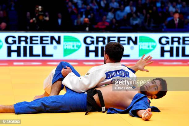 Beka Gviniashvili of Georgia easily holds Khusen Khalmurzaev of Russia for an ippon to win the u90kg final and the gold medal during the 2017...