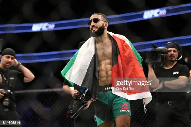 Belal Muhammad celebrates after his victory over Jordan Mein in their welterweight bout during the UFC 213 event at TMobile Arena on July 9 2017 in...