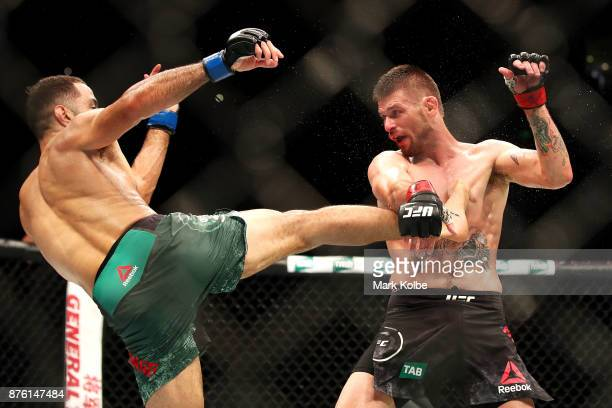 Belal Muhammad of the USA kicks Tim Means of the USA in their welterweight bout during the UFC Fight Night at Qudos Bank Arena on November 19 2017 in...