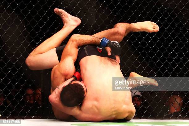 Belal Muhammad of the USA takes down Tim Means of the USA in their welterweight bout during the UFC Fight Night at Qudos Bank Arena on November 19...
