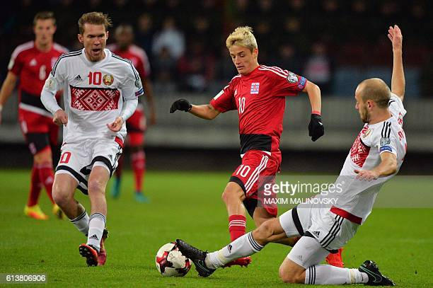 Belarus' Aleksandr Hleb and Belarus' Ivan Maevski vie with Luxembourg's Vincent Thill during the WC 2018 football qualification match between Belarus...