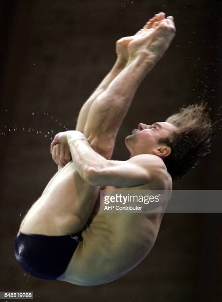 Belarus' Alexander Varlamov dives during the men's 10m plateform at the European Swimming Championships in Madrid 14 May 2004 AFP PHOTO JAVIER...