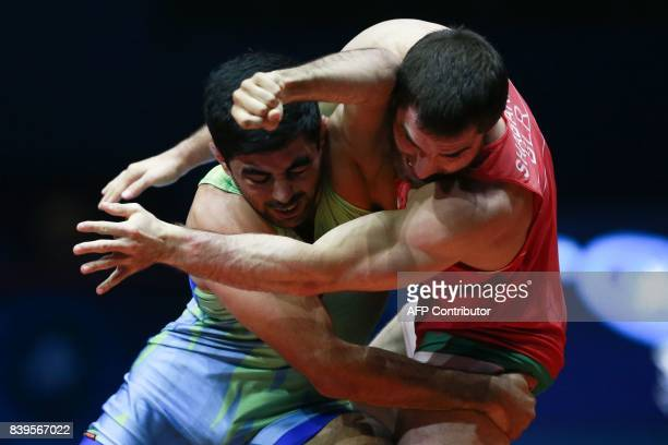 Belarus' Ali Shabanau challenges Uzbekistan's Bekzod Abdurakhmonov during the men's freestyle wrestling 74kg category bronze medal playoffs at the...