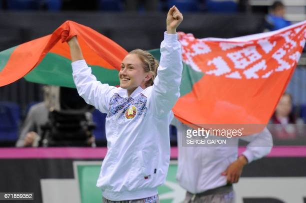 Belarus' Aliaksandra Sasnovich celebrates after winning the semifinals of the Fed Cup tennis competition between Belarus and Switzerland in Minsk on...