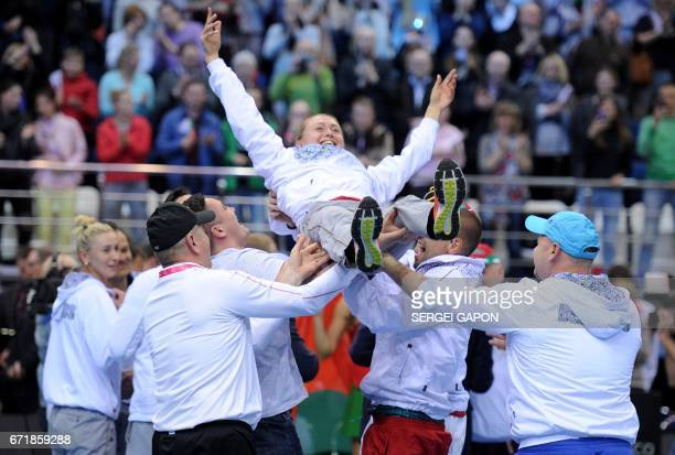 Belarus' Aliaksandra Sasnovich celebrates with her teammates after winning the semifinals of the Fed Cup tennis competition between Belarus and...