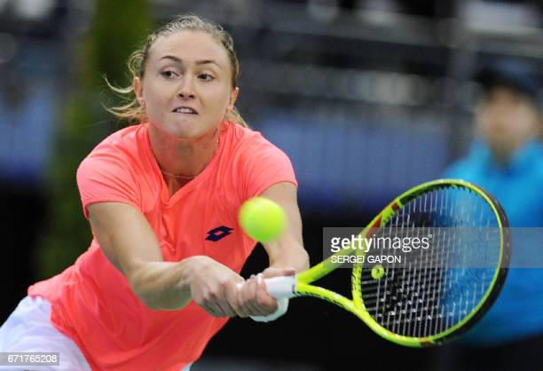 Belarus' Aliaksandra Sasnovich returns the ball to Switzerland's Timea Bacsinszky during the semifinals of the Fed Cup tennis competition between...