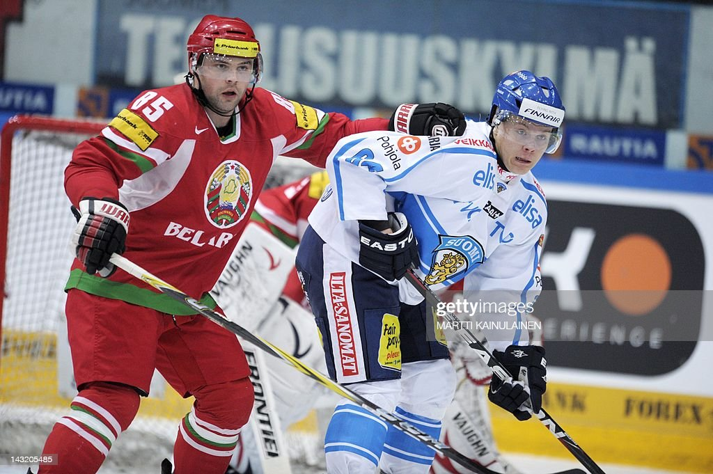 Belarus' Andrei Antonov (L) vies with Finland's Mikael Granlund during an Euro Hockey Challenge (EHC) ice hockey match Finland vs Belarus in Tampere, on April 21, 2012. AFP PHOTO / LEHTIKUVA / Martti Kainulainen
