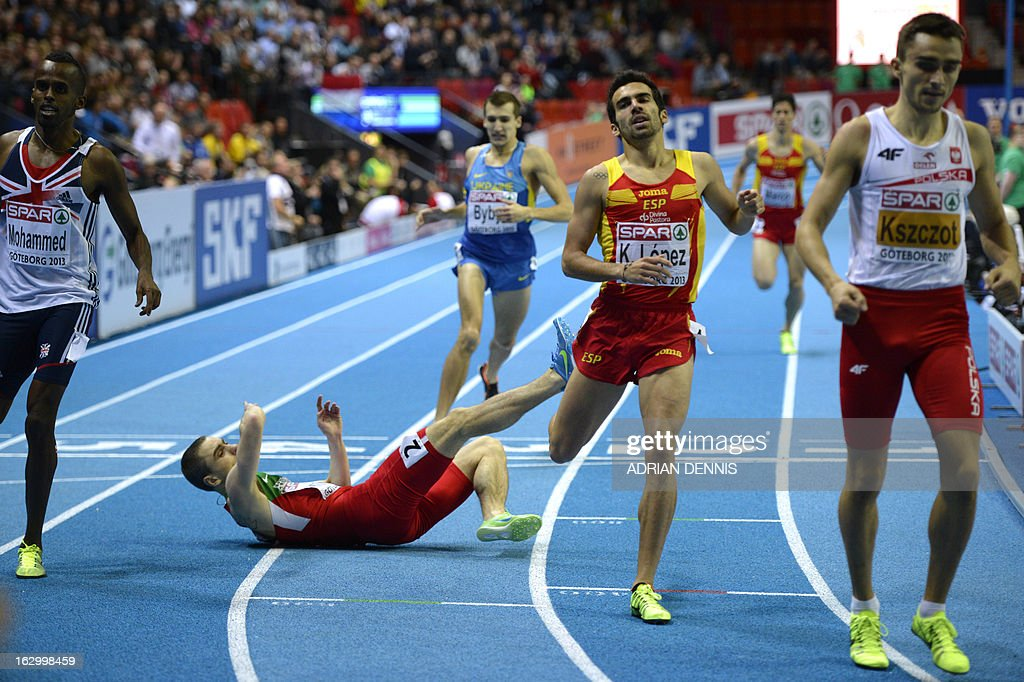 Belarus Anis Ananenka (2dL) lies on the track after crossing the finish line next to Poland's Adam Kszczot (R) in the Men's 800m final event at the European Indoor Athletics Championships in Gothenburg, Sweden, on March 3, 2013. AFP PHOTO / ADRIAN DENNIS