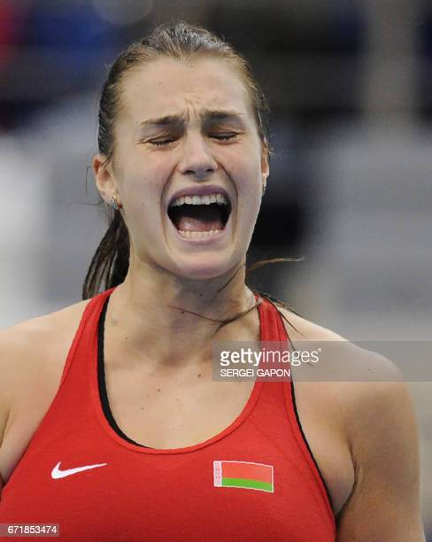Belarus' Aryna Sabalenka celebrates her victory over Switzerland's Viktorija Golubic during the semifinals of the Fed Cup tennis competition between...