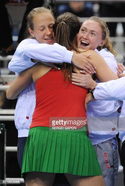 Belarus' Aryna Sabalenka celebrates her victory over Switzerland's Viktorija Golubic with her teammates during the semifinals of the Fed Cup tennis...