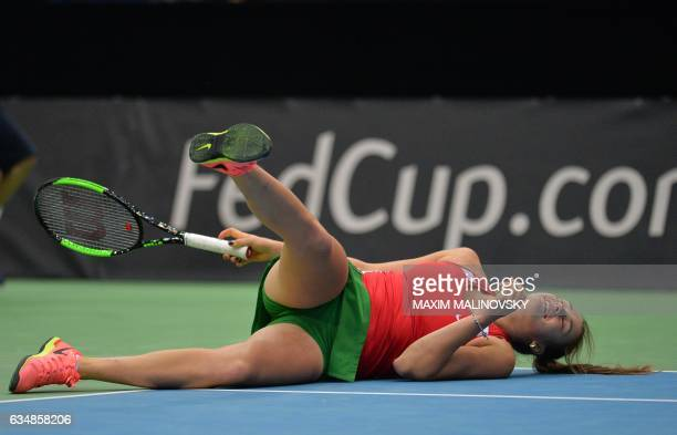 Belarus Aryna Sabalenka falls down during the Fed Cup World Group first round tennis match against Dutch Michaella Krajicek between Belarus and...