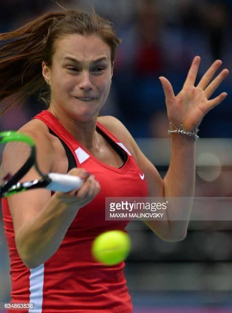 Belarus Aryna Sabalenka returnes a service to Dutch Michaella Krajicek during the Fed Cup World Group first round tennis match against between...