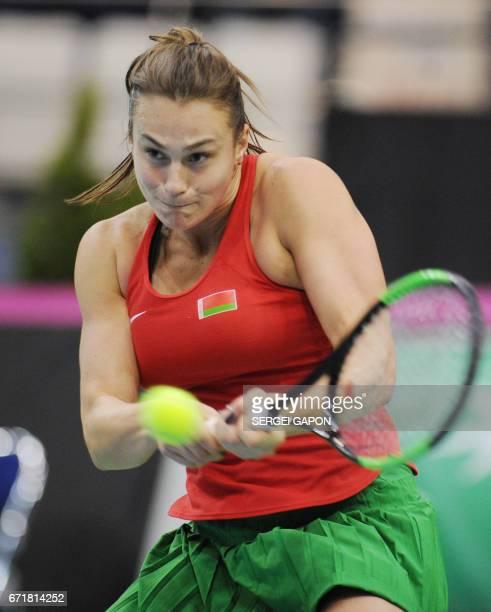 Belarus' Aryna Sabalenka returns the ball to Switzerland's Viktorija Golubic during the semifinals of the Fed Cup tennis competition between Belarus...