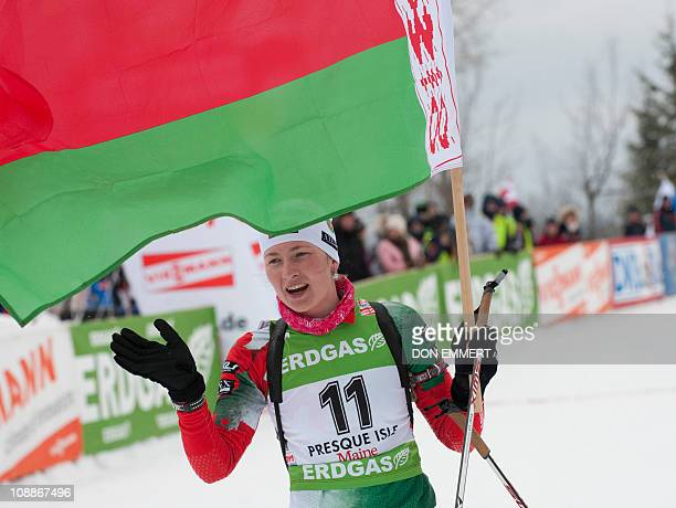 Belarus' Darya Domracheva holds her country's flag in the finish area of the IBU World Cup Biathlon Women's 10 km Pursuit on February 6 2011 in...