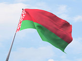 Belarus flag flying on clear sky.