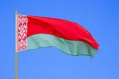 Belarus flag is waving in front of blue sky