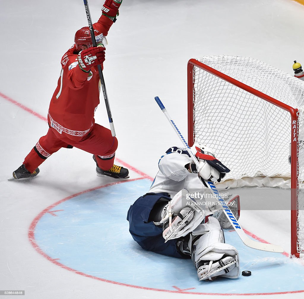 Belarus' forward Andrei Stas celebrates a goal past Finland's goalie Mikko Koskinen eyes the puck in his netduring the group B preliminary round game Finland vs Belarus at the 2016 IIHF Ice Hockey World Championship in St. Petersburg on May 6, 2016. / AFP / ALEXANDER