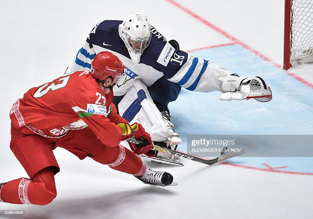 Belarus' forward Andrei Stas scores past Finland's goalie Mikko Koskinen during the group B preliminary round game Finland vs Belarus at the 2016 IIHF Ice Hockey World Championship in St. Petersburg on May 6, 2016. / AFP / ALEXANDER
