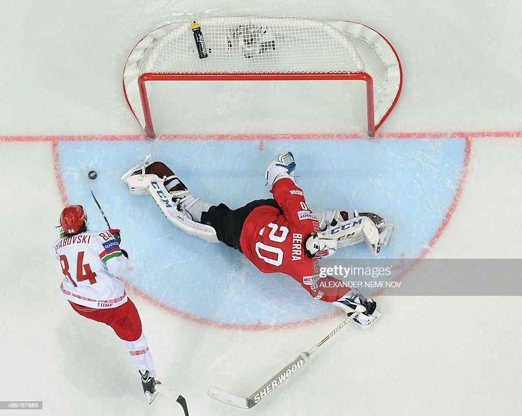 Belarus' forward Mikhail Grabovski scores a decisive goal past Switzerland's goalie Reto Berra during a preliminary round group B game Switzerland vs Belarus of the IIHF International Ice Hockey World Championship in Minsk on May 12, 2014. AFP PHOTO / ALEXANDER NEMENOV