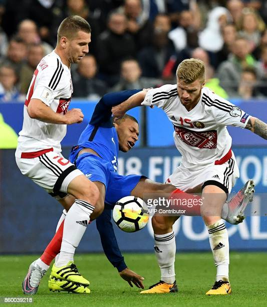 Belarus' forward Nikita Korzun vies with France's forward Kylian Mbappe during the FIFA World Cup 2018 qualification football match between France...