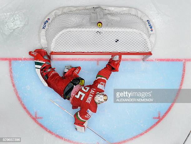 Belarus' goalie Kevin Lalande lets the puck into his net during the group B preliminary round game Belarus vs Canada at the 2016 IIHF Ice Hockey...